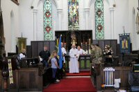 Members of the Church, Alfreton ACF, Scouts and Guides preparing to leave after the service.